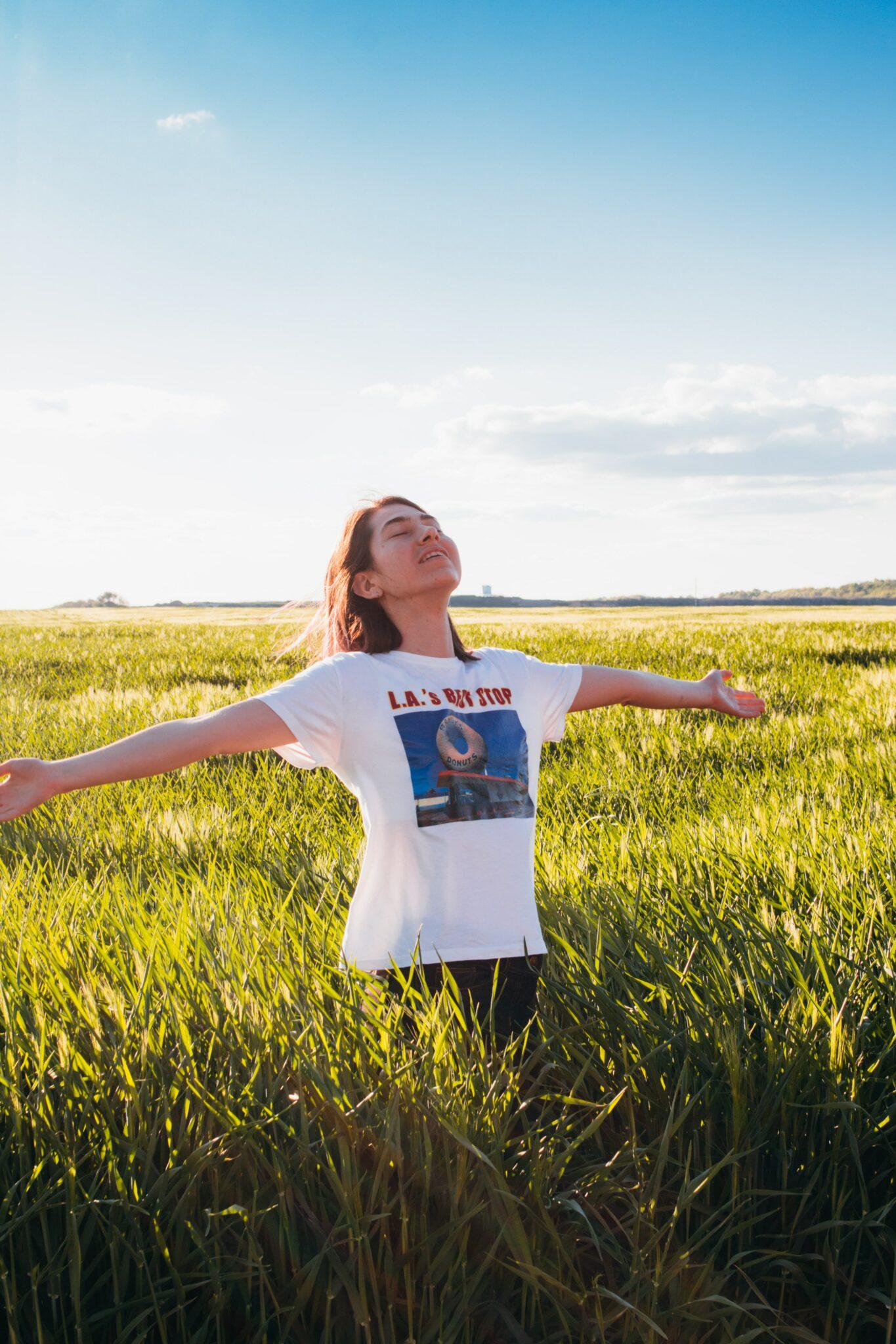 woman standing in green field